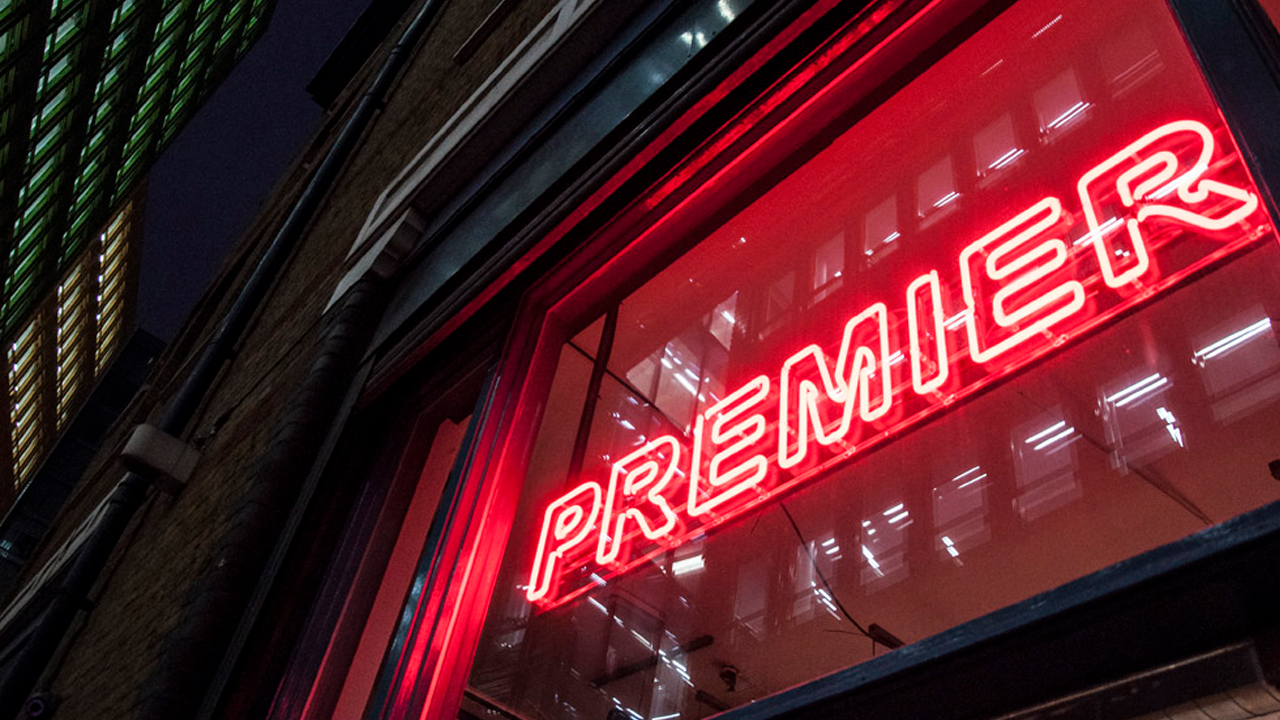 Premier neon sign outside building
