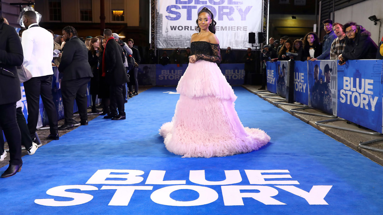 An actress on the blue carpet for the Blue Story premiere.
